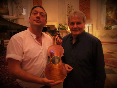 Violinist Paolo Ciociola with curator E. Marinucci showing the 1810 Pique violin before concert